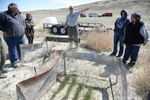 Russ Lawrence, Natural Resources Manager at the Utah Test and Training Range, discsses how the UTTR is gradually working on getting rid of cheat grass and cultivating more natural growth of better and nutritious vegetation for the land and wildlife. The exchange occurred on a tour of the range April 20, 2018, during Annual American Indian Meeting, in which Hill Air Force Base was a co-host. The meeting was held for government-to-government conversations, tours of UTTR, and official tribal co-host presentations. (U.S. Air Force photo by Cynthia Griggs)