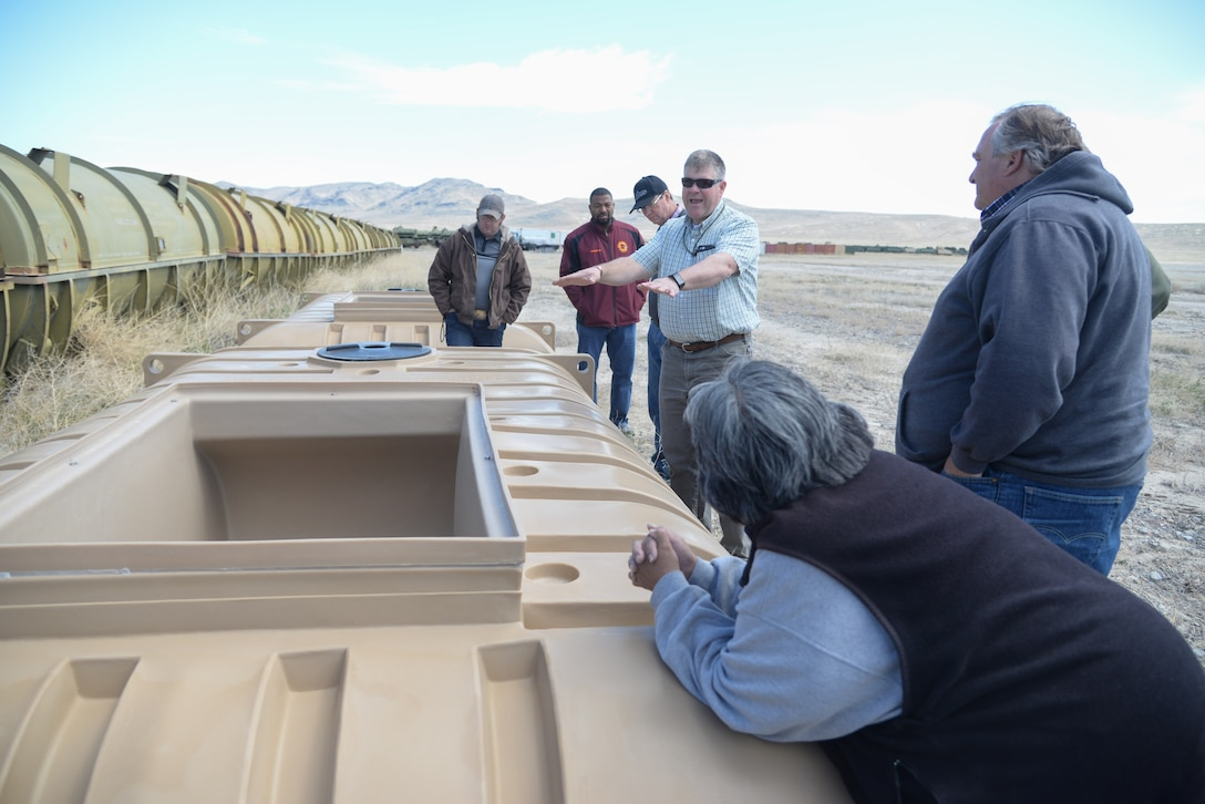 Russ Lawrence, Natural Resources Manager at the Utah Test and Training Range, discussed how the UTTR uses guzzlers, a type of water source for wildlife found on the range. The exchange occurred on a tour of the range April 20, 2018, during Annual American Indian Meeting, in which Hill Air Force Base was a co-host. The meeting was held for government-to-government conversations, tours of UTTR, and official tribal co-host presentations. (U.S. Air Force photo by Cynthia Griggs)