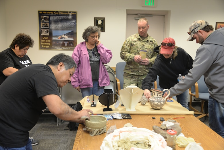 Carlos Laate, an artist from Zuni Pueblo, New Mexico, demonstrates his pottery for the attendees of the Annual American Indian Meeting held at Utah Test and Training Range April, 20, 2018, in which Hill Air Force Base was a co-host. The meeting was held for government-to-government conversations, tours of range, and official tribal co-host presentations. (U.S. Air Force photo by Cynthia Griggs)