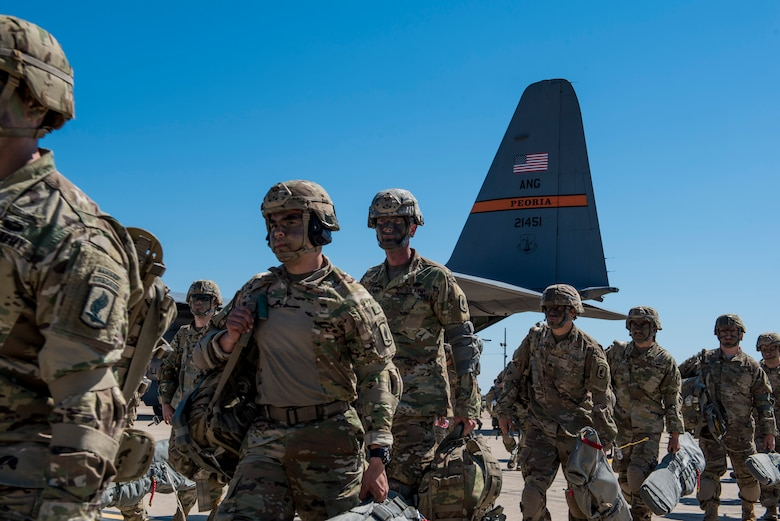 U.S. Army paratroopers from the Texas Army National Guard 1st Battalion (Airborne), 143rd Infantry Regiment, stationed at Camp Swift in Bastrop, Texas, prepare to load onto a C-130H Hercules aircraft, during the Minuteman Joint Forcible Entry exercise at Naval Air Station Joint Reserve Base Fort Worth, Texas, April 20, 2018.