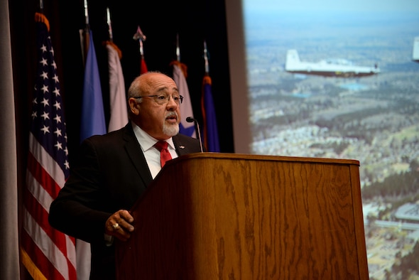 Retired Col. Cesar Rodriguez, a former F-15 Eagle pilot, speaks at the Specialized Undergraduate Pilot Training Class 18-08 graduation April 27, 2018, on Columbus Air Force Base, Mississippi. Rodriguez spoke about the importance of family, friends and teamwork for every Airmen and leader in the Air Force. (U.S. Air Force photo by Airman 1st Class Keith Holcomb)