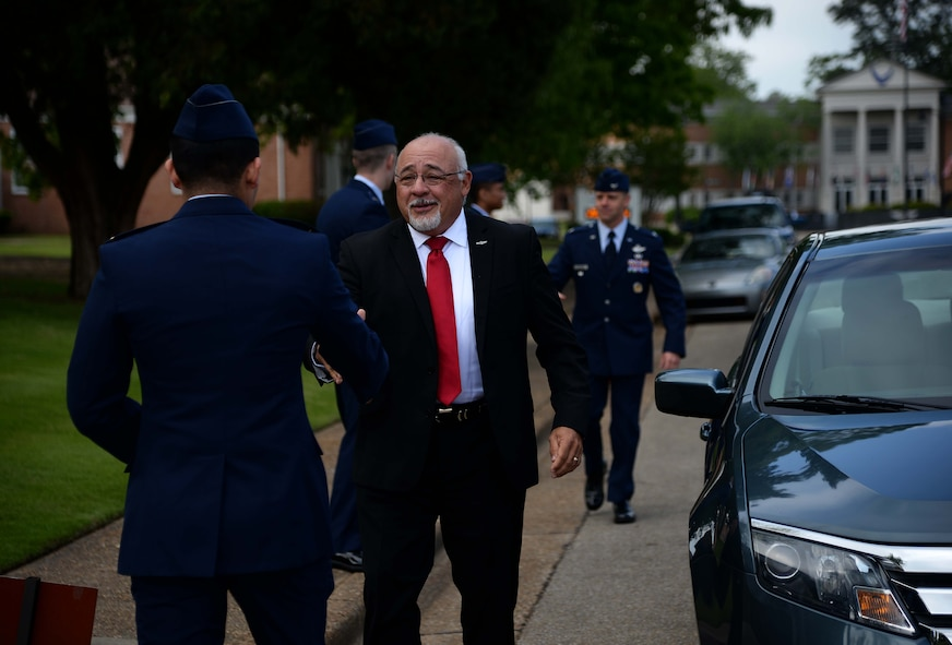Retired Col. Cesar Rodriguez, a former F-15 Eagle pilot, greets a student pilot April 27, 2018, on Columbus Air Force Base, Mississippi, before speaking at the Specialized Undergraduate Pilot Training Class 18-08 graduation. Rodriguez served 25 years in the U.S. Air Force, recorded more than 3,100 fighter flight hours, 350 of which were combat hours during Desert Storm and Allied Force. (U.S. Air Force photo by Airman 1st Class Keith Holcomb)