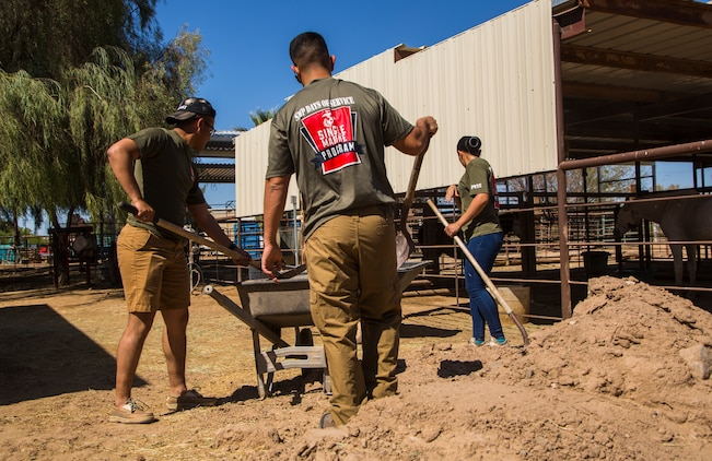 """U.S. Marines stationed on Marine Corps Air Station (MCAS) Yuma, Ariz., volunteer with Saddles of Joy, a local organization that provides therapy to special needs children through animals, Friday, April 20, 2018. While at the Saddles of Joy, the volunteers mucked horse stables, sheared sheep, groomed horses, and provided much needed physical help to the organization. Saddles of Joy was one of the volunteer opportunities provided to Marines aboard MCAS Yuma during the """"Days of Service"""" initiative; other opportunities included the Humane Society of Yuma, the Yuma Food Bank, and Old Souls Animal Farm."""