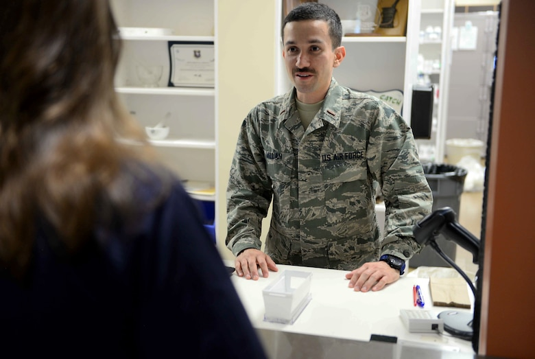 Second Lt. Edison Millan, 14th Student Squadron student pilot and augmented pharmaceutical assistant, May 1, 2018 on Columbus Air Force Base, Mississippi. The 14th Medical Group and every group on Columbus AFB has the help of lieutenants who are waiting for their training to start, they fill positions to assist Airman in day to day unclassified operations. (U.S. Air Force photo by Airman 1st Class Keith Holcomb)