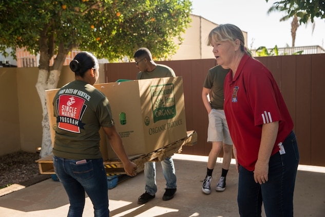 """U.S. Marines stationed on Marine Corps Air Station (MCAS) Yuma, Ariz., volunteer with the Yuma Food Bank Wednesday, April 18, 2018. While volunteering for the Yuma Food Bank, the volunteers picked oranges and boxed the fruits for the food bank. Yuma Food Bank was one of the volunteer opportunities provided to Marines aboard MCAS Yuma during the """"Days of Service"""" initiative; other opportunities included the Humane Society of Yuma, Saddles of Joy, and Old Souls Animal Farm."""