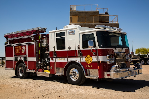 "Two newly hired firefighters with Marine Corps Air Station (MCAS) Yuma's fire department conduct ""New Hire Training"" at the stations fire department training building aboard MCAS Yuma, Ariz., Tuesday, April 17, 2018. The training teaches new firefighters all the basic skills they need to be successful at their job. This includes: how to climb the ladder, basic EMS training, how to employ and use the fire hose, and rescue drags used for removing civilians from dangerous environments. (U.S. Marine Corps photo by Cpl. Isaac D. Martinez)"