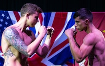 U.S. Marine Corps Cpl. Christian Valdes, right, an aviation logistics information management and support specialist with Marine Aviation Logistics Squadron 39 and boxer with the 1st Marine Division boxing team, faces his opponent British Royal Marine 1st Class Danny Smith, during the official weigh-in at the Commando Training Centre for the Royal Marines Lympstone, England, May 3, 2018. The 1st MARDIV boxing team and RMs were scheduled to compete in a friendly boxing exposition to strengthen the bond of both counterparts.