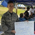 Staff Sgt. David Flynn, 94th Aeromedical Staging Squadron diet technician, samples his Super Food Salad at Dobbins Family Day. Flynn works as a Diet Technician to improve the overall health of his fellow Citizen Reserve Airmen. (Courtesy photo)