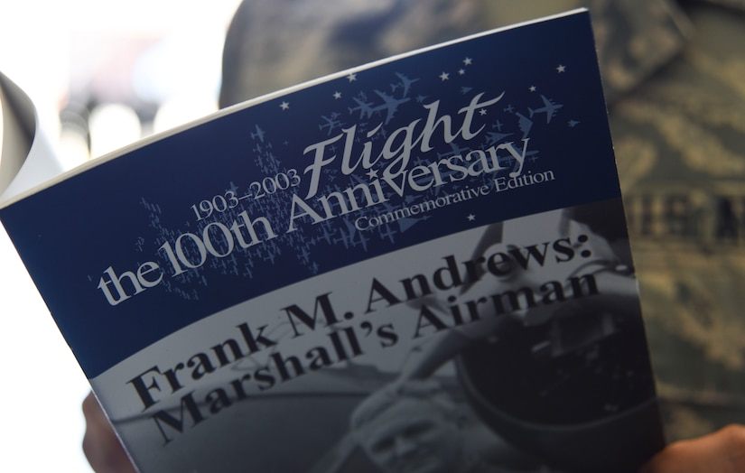 Airman reads history pamphlet