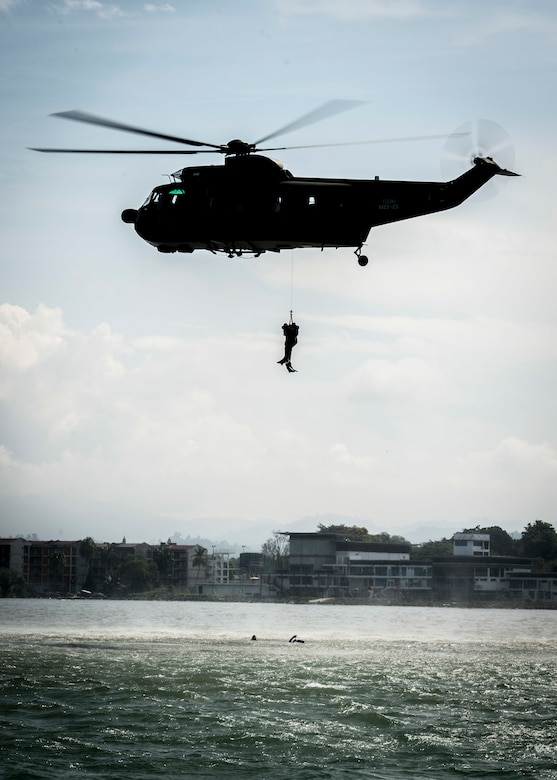 A Malaysian air force helicopter rescues mock casualties as part of a maritime search-and-rescue exercise during Pacific Partnership 2018 in Tawau, Malaysia.