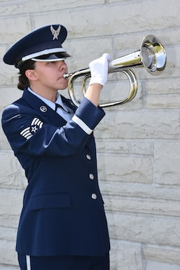 Staff Sgt. Jacquelyn Eye, a member of the Missouri Air National Guard Funeral Honors team, performs Taps for a ceremony at Jefferson Barracks National Cemetery, April 30, 2018, in honor of World War II combat aviator and former 131st Tactical Fighter Wing commander, Brig. Gen. Harding Zumwalt.  (U.S. Air National Guard photo by Senior Master Sgt. Mary-Dale Amison)