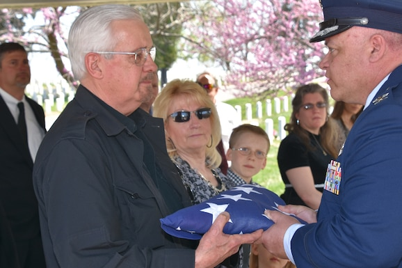 Col. Ken Eaves, 131st Bomb Wing commander, presents Jeffrey Zumwalt a tribute flag in honor of Zumwalt's father, Brig. Gen. Harding Zumwalt, during a ceremony at Jefferson Barracks National Cemetery, April 30, 2018. Family, friends and Missouri Air National Guard family met to celebrate the life of the World War II combat aviator and former 131st Tactical Fighter Wing commander, Brig. Gen. Harding Zumwalt, who passed away in January at age 97.  (U.S. Air National Guard photo by Senior Master Sgt. Mary-Dale Amison)