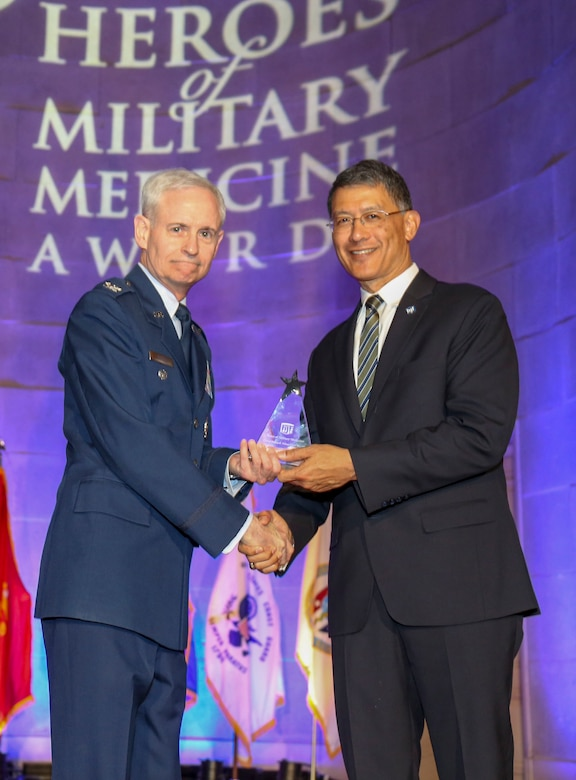U.S. Air Force Maj. Gen. (retired) Joseph Caravalho (right), president, Henry M. Jackson Foundation for the Advancement of Military Medicine, congratulates U.S. Air Force Col. William E. Nelson, chief, integrated and international operational medicine, 711th Human Performance Wing, after receiving the 2018 Heroes of Military Medicine Award in Washington, D.C., May 3, 2018. Col. Nelson was recognized for his exemplary career as an Air Force flight surgeon, and for his contributions to the Air Force Integrated Operational Support mission. (Courtesy photo illustration by Henry M. Jackson Foundation for the Advancement of Military Medicine)