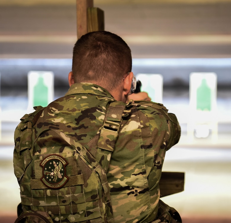 2nd Lt. Mark Stacy, 90th Missile Security Forces Squadron flight commander, aims down the sights of an M-9 Berretta March 23, 2018, at the Combat Arms Training and Maintenance range on F.E. Warren Air Force Base Wyo. On top of teaching and qualifying non security Airmen, CATM also helps missile security forces and base security forces personnel requalify on the weapons they use in their everyday job. Combat Arms Training and Maintenance is a vital component to keeping our Airmen trained and qualified on the weapon systems they are issued when performing security on home station or deployed. (U.S. Air Force photo by Airman 1st Class Braydon Williams)