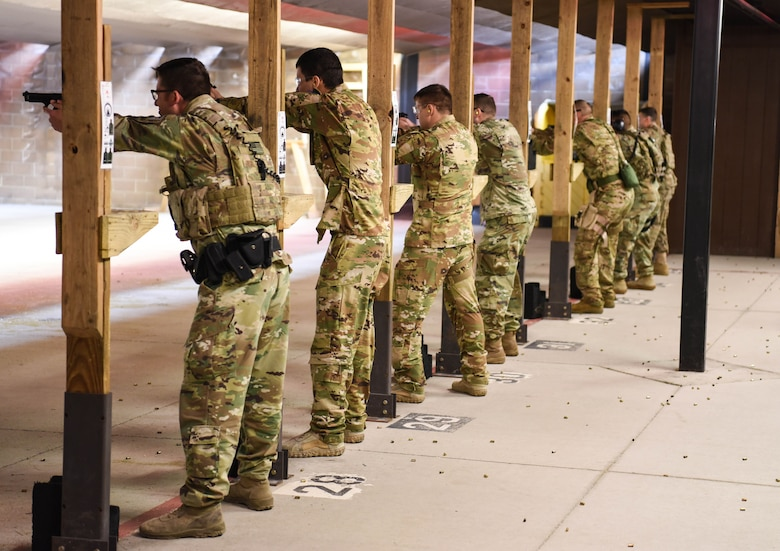 Defenders from the 90th Security Forces Group aim their weapons March 23, 2018, at the Combat Arms Training and Maintenance range on F.E. Warren Air Force Base Wyo. Security forces members have to complete sustainment firing, such as Shoot Move Communicate. Combat Arms Training and Maintenance is a vital component to keeping our Airmen trained and qualified on the weapon systems they are issued whether providing security on home station or deployed. (U.S. Air Force photo by Airman 1st Class Braydon Williams)