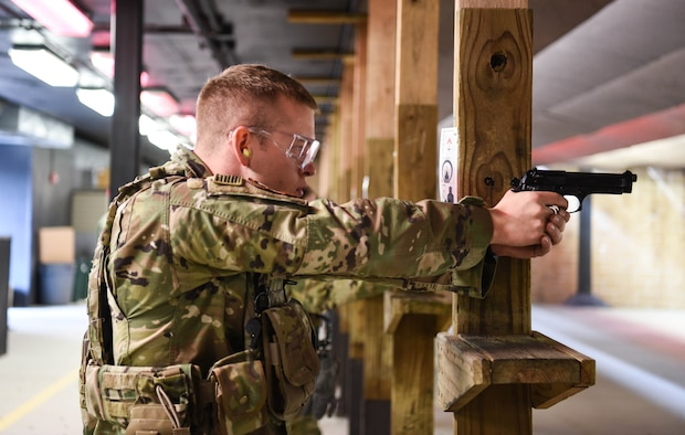 2nd Lt. Mark Stacy, 90th Missile Security Forces Squadron flight commander, prepares to fire an M-9 Berretta March 23, 2018, at the Combat Arms Training and Maintenance range on F.E. Warren Air Force Base Wyo. CATM instructors train military and civilian personnel to be proficient with whichever weapon they will be carrying. On top of teaching and qualifying non security Airmen, CATM also helps missile security forces and base security forces personnel requalify on the weapons they use in their everyday job.  Combat Arms Training and Maintenance, is a vital component to keeping our Airmen trained and qualified on the weapon systems they are issued when performing security. (U.S. Air Force photo by Airman 1st Class Braydon Williams)