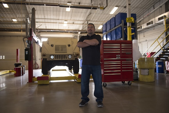 Julio Cedillo, a Vehicle Maintenance and control assistant assigned to the 97th Logistics Readiness Squadron, stands in the vehicle maintenance shop, April 17, 2018, at Altus Air Force Base, Okla.