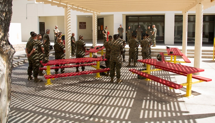 Newly promoted U.S. Marine Corps corporals assigned to Marine Corps Air Station (MCAS) Yuma Headquarters & Headquarters Squadron (H&HS) received their blood stripes during a Blood Stripe Ceremony in front of the H&HS building May 3, 2018. The blood stripe honors the blood that was shed by Marine officers and noncommissioned officers (NCO) during the Battle of Chapultepec in 1847. The blood stripes are sewn on the trousers of NCOs, Staff NCOs, and officers in remembrance of those who courageously fought in the battle. (U.S. Marine Corps photo by Lance Cpl. Sabrina Candiaflores)