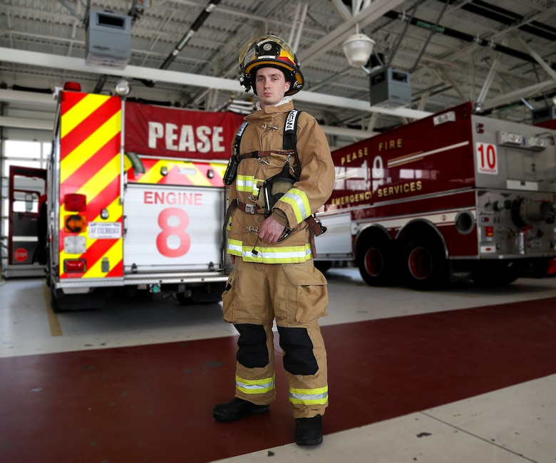 Senior Airman Alex J. Lane, an aircraft rescue firefighter assigned to the 157th Air Refueling Wing Fire Department, poses for a portrait behind a fire engine on May 4, 2018 at Pease Air National Guard Base, N.H. Lane completed his technical training in 2014. (N.H. Air National Guard photo by Staff Sgt. Kayla White)