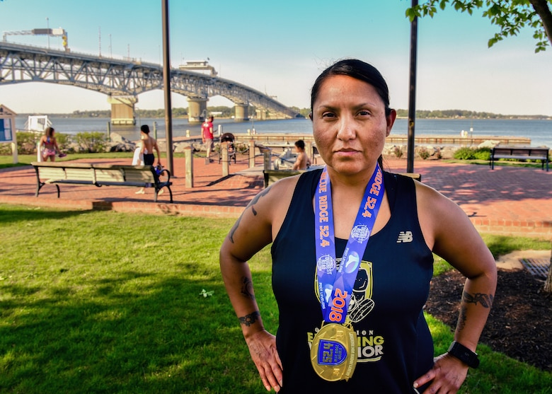 U.S. Army Master Sgt. Jessica Begay, U.S. Army Training and Doctrine Command Inspector General assistant inspector general, poses in Yorktown, Virginia, May 2, 2018. Begay participates in different group runs each day of the week as a way to maintain running stamina while spending time with friends. (U.S. Air Force photo by Airman 1st Class Monica Roybal)