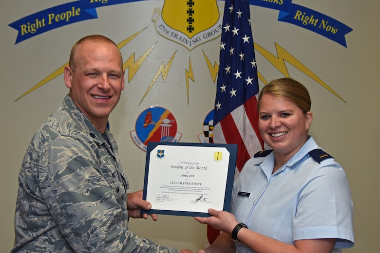 U.S. Air Force Lt. Col. Steven Watts, 17th Training Group deputy commander, presents the 315th Training Squadron Officer Student of the Month award to 2nd Lt. Holynne Steppe, 315th TRS trainee, at Brandenburg Hall on Goodfellow Air Force Base, Texas, May 4, 2018. The 315th TRS's vision is to develop combat-ready intelligence, surveillance and reconnaissance professionals and promote an innovative squadron culture and identity unmatched across the U.S. Air Force. (U.S. Air Force photo by Airman 1st Class Zachary Chapman/Released)