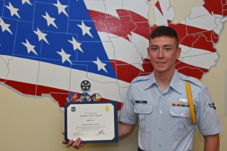 17th Training Group Student of the Month spotlight for May 2018, U.S. Air Force Airman Jonah Chose, 316th Training Squadron trainee, poses with his award at Brandenburg Hall on Goodfellow Air Force Base, Texas, May 4, 2018. Chose is the Goodfellow Student of the Month spotlight for May 2018, a series highlighting Goodfellow students. (U.S. Air Force photo by Airman 1st Class Zachary Chapman/Released)