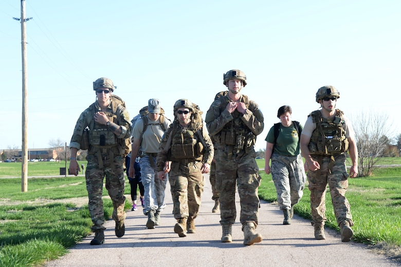 Members of the 28th Civil Engineer Squadron Explosive Ordnance Disposal Flight participate in the 50th Anniversary EOD Memorial Day ruck march at Ellsworth Air Force Base, S.D., May 4, 2018. National EOD Memorial Day is designated by Congress as the first Saturday of May to honor of EOD technicians who lost their lives while conducting operations across the globe. (U.S. Air Force photo by Airman 1st Class Nicolas Z. Erwin)