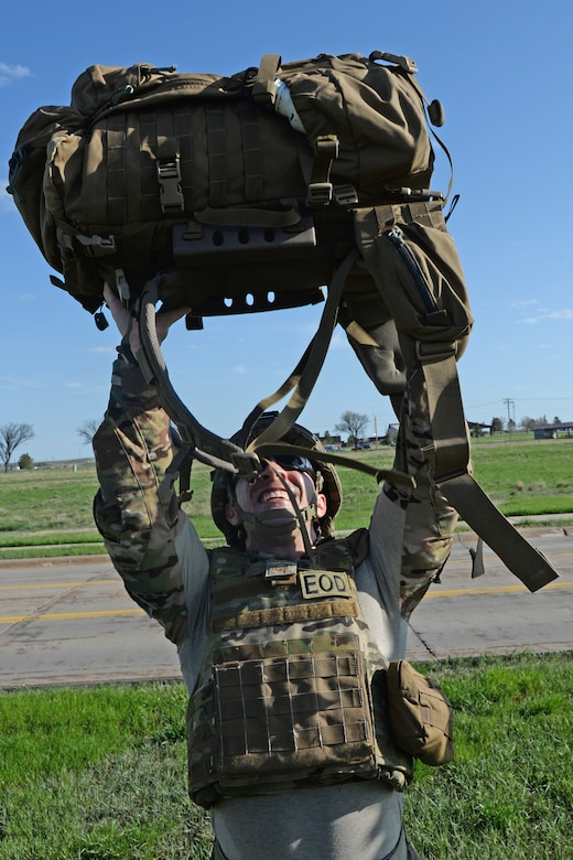 Master Sgt. Carlos Sanchez, 28th Civil Engineer Explosive Ordnance Disposal flight lead, performs 32 ruck presses during the 50th Anniversary EOD Memorial Day ruck march at Ellsworth Air Force Base, S.D., May 4, 2018. The 32 repetitions of the exercises represent the 32 fallen EOD Airmen who have been killed in the line of duty since 9/11.  (U.S. Air Force photo by Airman 1st Class Nicolas Z. Erwin)