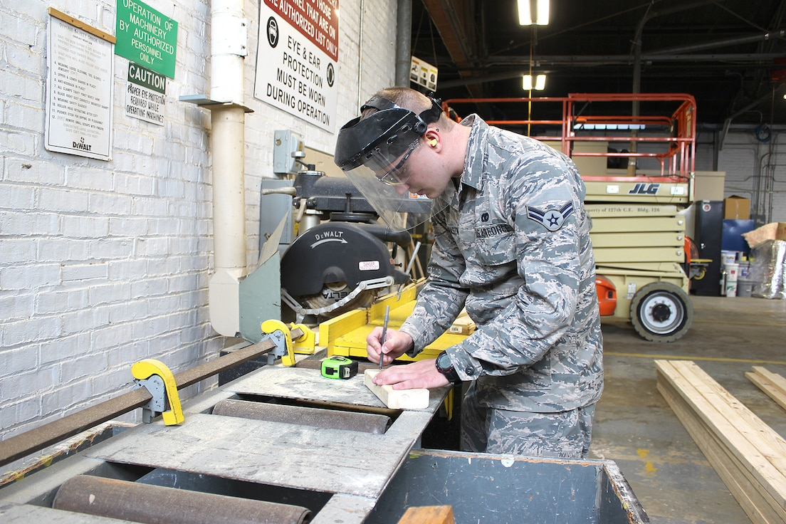 Airman 1st Class Paul Prohaszka, a member of the Structures flight of the 127th Civil Engineer Squadron, works in the wood shop at Selfridge Air National Guard Base, Mich., May 4, 2018. Michigan Citizen-Airmen at Selfridge conducted a four-day training drill at Selfridge to refresh career-specific and warfighting skills. (U.S. Air National Guard photo by Tech. Sgt. Dan Heaton)