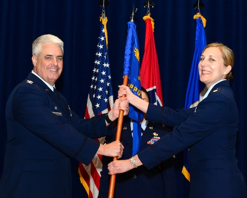 Col. Thomas Cauthen, 134th Air Refueling Wing commander, presents the 134th Mission Support Group guidon to Lt. Col. Lisa Godsey, MSG commander during a Change of Command ceremony May 5, 2018 at McGhee Tyson Air National Guard base, Tenn. Col. Russell Gaby, previous 134th MSG commander relinquished his command to Godsey, previously the 134th Medical Group deputy commander. (U.S. Air National Guard photo by Tech. Sgt. Daniel Gagnon)