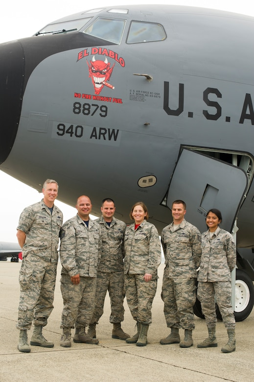 "The maintenance crew of the ""El Diablo"" KC-135 Stratotanker stand with the 940th Air Refueling Wing commander and vice commander on the flightline after revealing the aircraft's nose art May 5 at Beale Air Force Base, California."