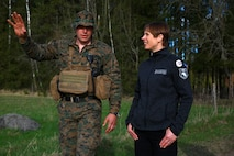 The President of Estonia Kersti Kaljulaid discusses Exercise Hedgehog with Marine Rotational Force-Europe (MRFE) 18.1 Bravo Company Commander Capt. Andrew Davis at Voru, Estonia, May 5, 2018. President Kaljulaid visited the Marines and Sailors of MRFE and spoke about the importance of Hedgehog, which is an annual event designed to strengthen strategic cooperation and partnership among participants. This the first time the Marine Corps has participated in the exercise, which also featured several other NATO countries. (U.S. Marine Corps photo by Gunnery Sgt. Clinton Firstbrook)