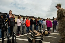 Various 52nd Fighter Wing squadrons invited students to experience a simulation of what their parents go through before deploying.