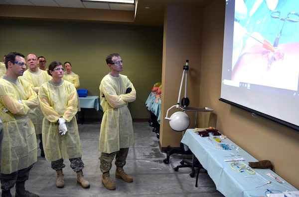 Brooke Army Medical Center Emergency Medicine faculty and residents observe an advanced vascular access technique demonstration at the Bulverde Centre for Emergency Health Sciences as part of EMS Residents Day March 29.