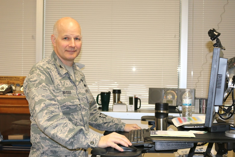 Col. Raymond Briggs, chief of the Test Systems Sustainment Division at Arnold AFB, works in his office at Arnold Air Force Base. Briggs will be retiring from the Air Force and his position at Arnold. (U.S. Air Force photo/Deidre Ortiz)