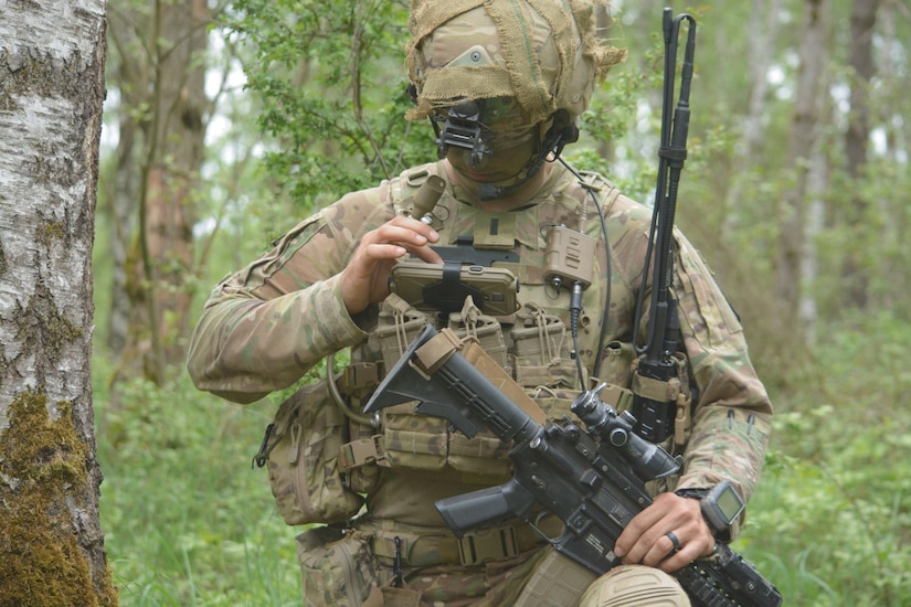 Army 1st. Lt. Michael Austin, a platoon leader for Attack Co., 1st Battalion, 503rd Infantry Regiment, uses an end user device.