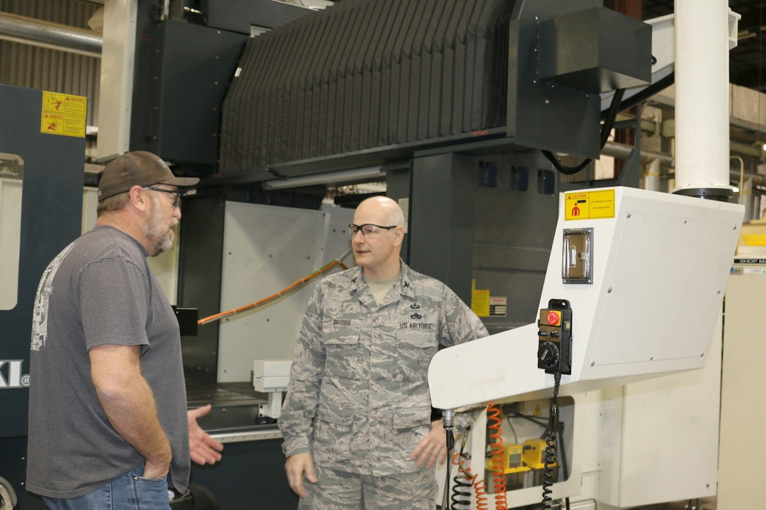 Col. Raymond Briggs, right, speaks to Gregg Adams regarding the new machinery and equipment recently purchased for the Model and Machine Shop at Arnold Air Force Base. Briggs, chief of the Test Systems Sustainment Division at Arnold AFB, will be retiring from the Air Force this month. (U.S. Air Force photo/Deidre Ortiz)