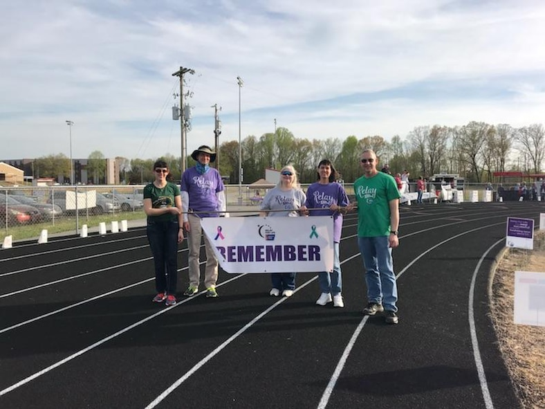 Members of 2018 Team REMEMBER display their banner while walking the track at the Relay For Life event held at Coffee County Raider Academy April 21. Pictured is Amber Wolfe, Pat Long, Rhonda Ward, Dee Wolfe and Shawn Wolfe. (Courtesy photo)