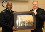 DLA Troop Support Commander Army Brig. Gen. Mark Simerly presents the DLA Director Army Lt. Gen. Darrell Williams with a depiction of the Schuylkill Arsenal in Philadelphia on April 27.