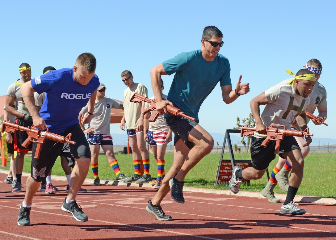 Come out to the gym track for the Defender Olympics May 15 at 10 a.m. Challenges will include a one minute, four-man push up challenge, 200 meter ammo can relay (4x200), mile relay (4x400), 50 meter high crawl relay, 1600 meter Indian sprint relay, 50 meter serpentine fireman carry relay, and MRE eating contest. For signups, contact TSgt Bronsha Smith by email at bronsha.smith@us.af.mil or by phone at 7-2103.(U.S. Air Force photo by Kenji Thuloweit)