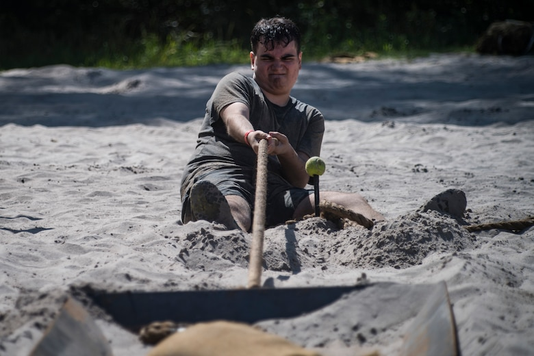 A Moody Mud Run participant attempts an obstacle, May 5, 2018, in Ray City, Ga. Participants trekked 4.6 miles through the mud, water and 29 obstacles that made up the course. This is the fifth year Moody has hosted the event and more than 800 patrons participated. (U.S. Air Force photo by Senior Airman Janiqua P. Robinson)