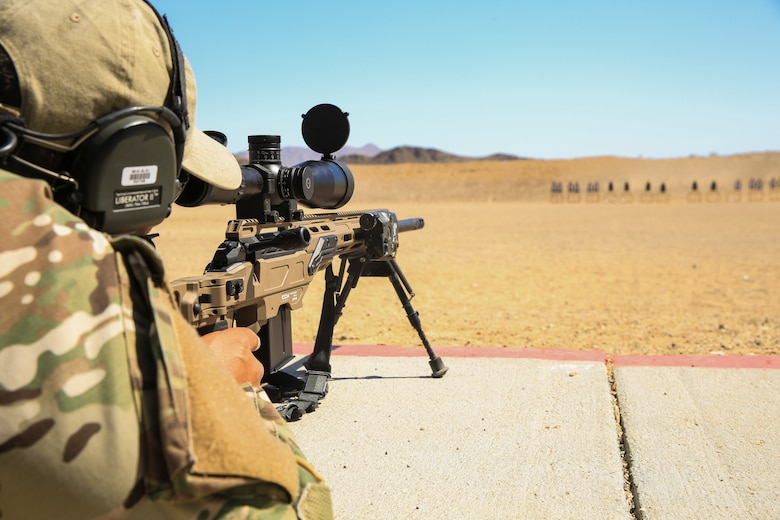 A sheriff from Williamson County, Texas, sights in down range during a sniper training course hosted by the Marksmanship Training Unit  aboard the Marine Corps Air Ground Combat Center, Twentynine Palms, Calif., April 25, 2018. The sniper course was held from April 24 to April 27, 2018 to advance participants' skills in marksmanship techniques for combat scenarios. (U.S. Marine Corps photo by Lance Cpl. Isaac Cantrell)