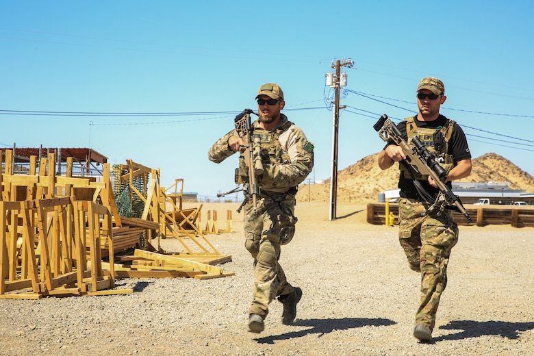 gents from the Federal Bureau of Investigation conduct a speed and target locating drill during a sniper training course aboard the Marine Corps Air Ground Combat Center, Twentynine Palms, Calif., April 25, 2018. The sniper course was held from April 24 to April 27, 2018 to advance participants' skills in marksmanship techniques for combat scenarios.  (U.S. Marine Corps photo by Lance Cpl. Isaac Cantrell)