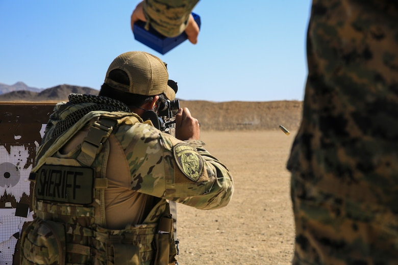 A sheriff from Williamson County sends rounds down range during a sniper training course hosted by the Marksmanship Training Unit aboard the Marine Corps Air Ground Combat Center, Twentynine Palms, Calif., April 25, 2018. The sniper course was held from April 24 to April 27, 2018 to advance participants' skills in marksmanship techniques for combat scenarios. (U.S. Marine Corps photo by Lance Cpl. Isaac Cantrell)