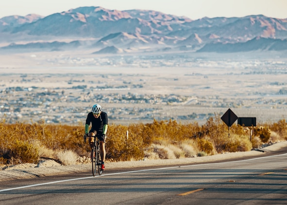 A participant of the 4th Annual Park-2-Park Bike Ride begins the 52-mile full course event in Twentynine Palms, Calif., April 28, 2018. The purpose of Park-2-Park is to bring families and friends of Twentynine Palms together in celebration of Earth Day. (U.S. Marine Corps photo by Lance Cpl. Rachel K. Porter)