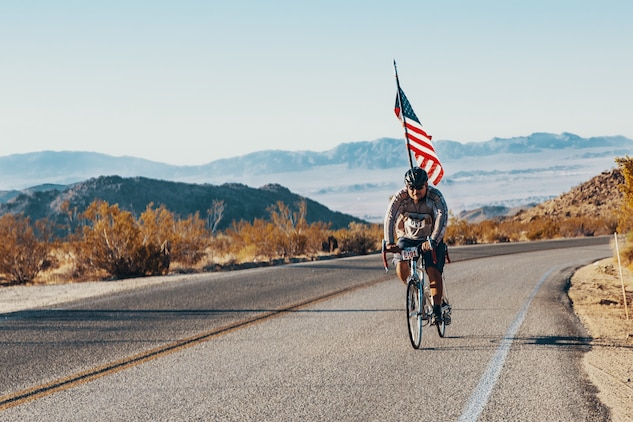 A participant of the 4th Annual Park-2-Park Bike Ride pedals the 52-mile full course through Joshua Tree National Park, Calif., April 28, 2018. The purpose of Park-2-Park is to bring families and friends of Twentynine Palms together in celebration of Earth Day.(U.S. Marine Corps photo by Lance Cpl. Rachel K. Porter)