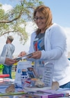 Blue Star Families Chapter Leader Savannah Hewett shares children's books during set-up at Kirtland Rockfest May 2 at the Mountain View Club. Hewett, also the 377th Security Forces Group Key Spouse, was recently recognized as the 2017 Team Kirtland Volunteer of the Year.