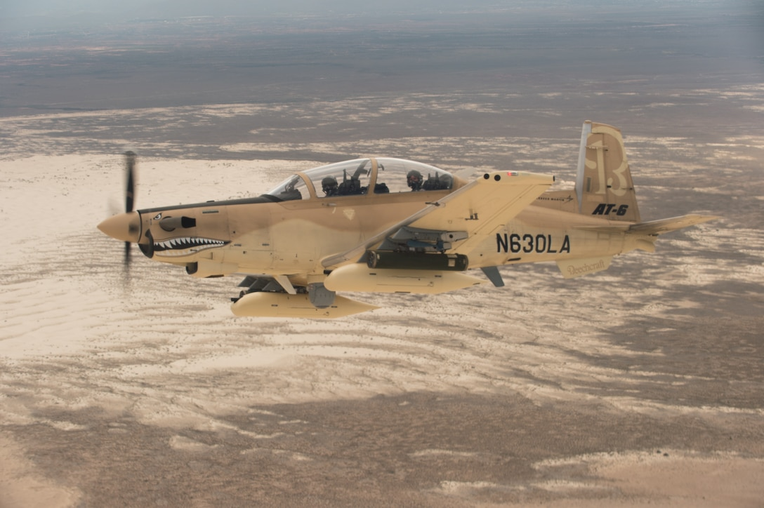 A Beechcraft AT-6 experimental aircraft flies over White Sands Missile Range, N.M. July 31, 2017. The AT-6 is participating in the U.S. Air Force Light Attack Experiment (OA-X), a series of trials to determine the feasibility of using light aircraft in attack roles. (U.S. Air Force photo by Ethan D. Wagner)