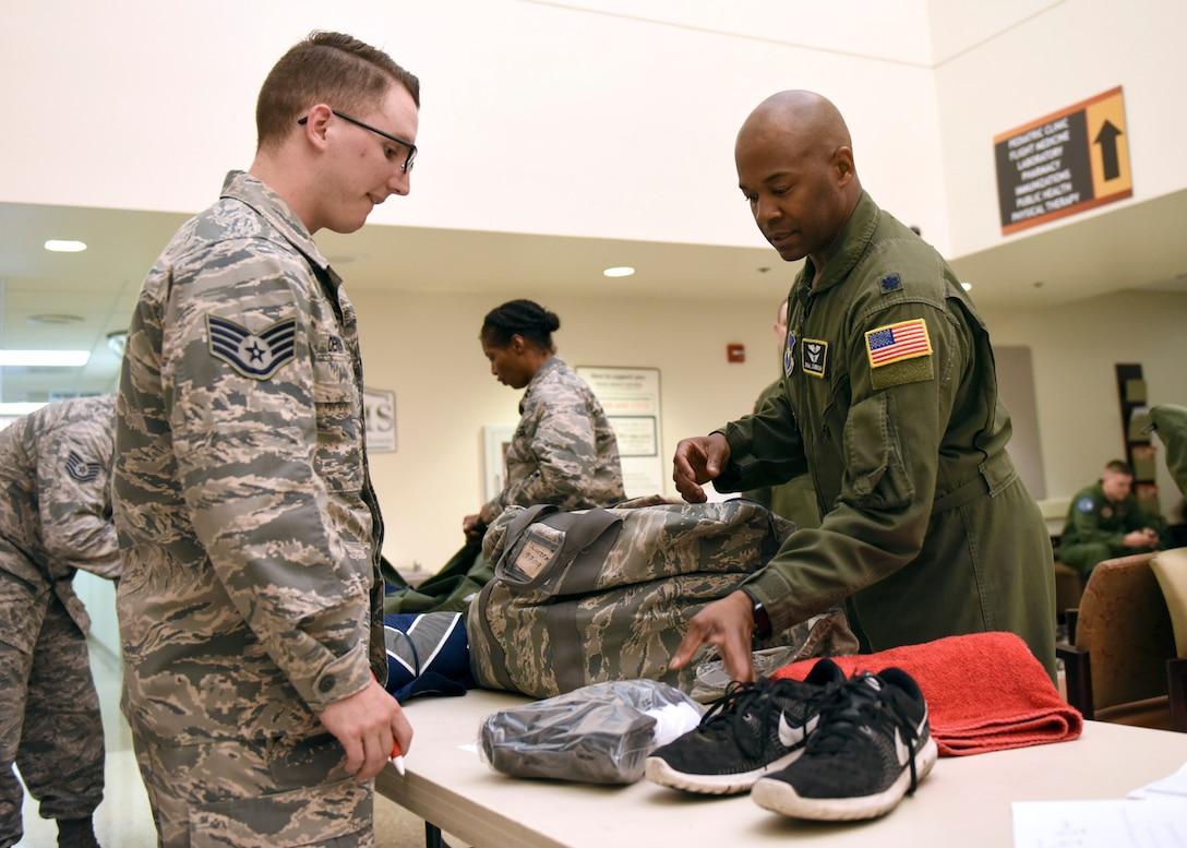 Staff Sgt. Micah Denson, 359th Medical Group flight medicine records clerk, inspects personal mobility bags during a recall at the Joint Base San Antonio-Randolph clinic, May 3. The recall was conducted to measure military preparedness, operational readiness mindset and to support the Air Force Medical Service and Defense Health Agency goals of a Medically Ready Force and a Ready Medical Force. (U.S. Air Force photo by Staff Sgt. Kevin Iinuma)