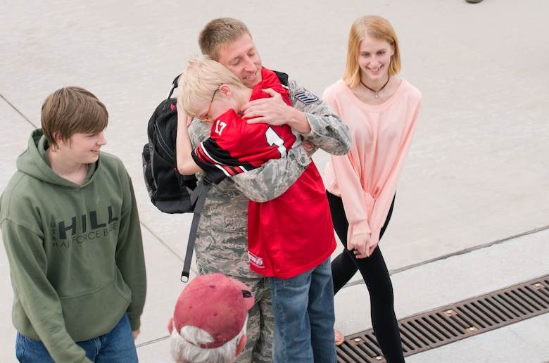 Upon returning home from a six-month deployment, Tech. Sgt. Lance Dooley, crew chief in the 419th Aircraft Maintenance Squadron, greets his children